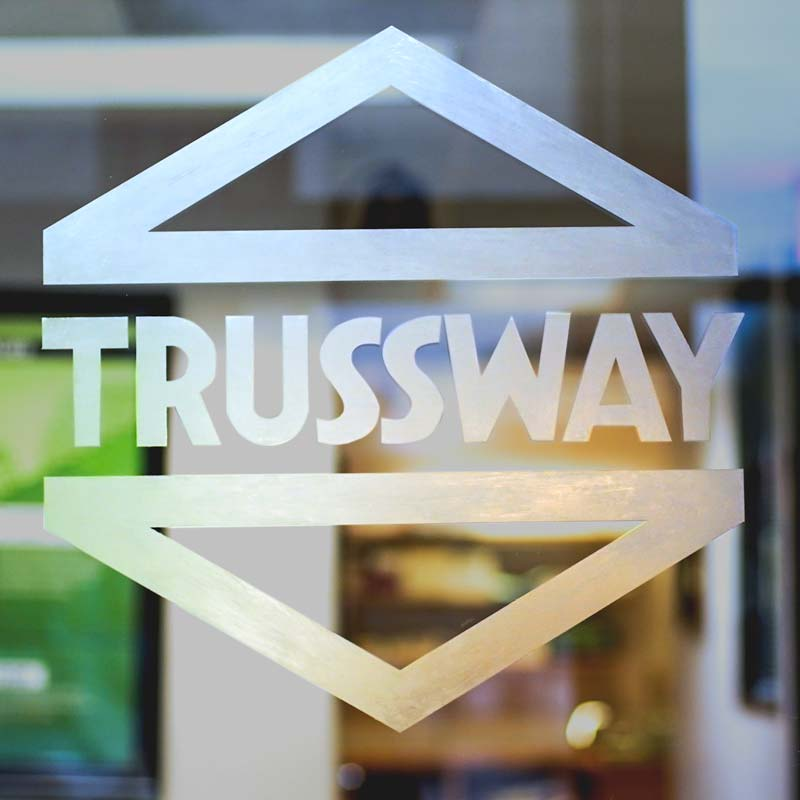 Office window with the Trussway logo on it