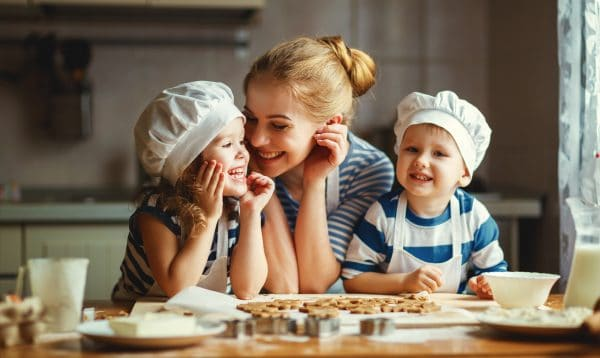 child caregivers baking with kids - trusting connections nanny agency