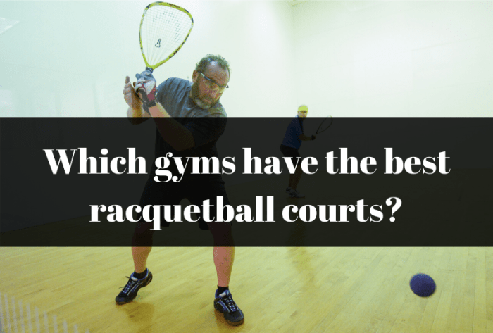 Men playing racquetball in gym