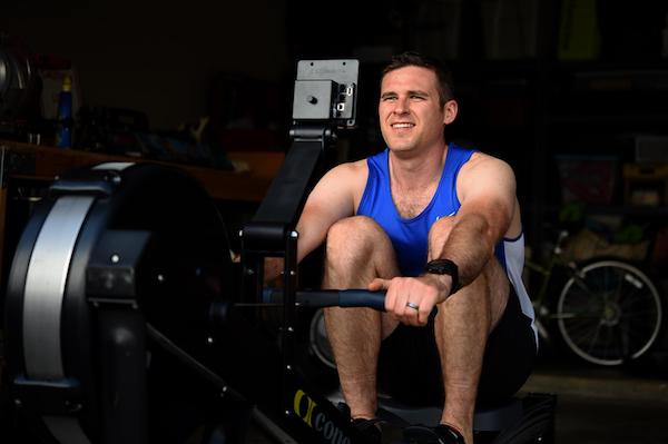 Man using rowing machine at gym
