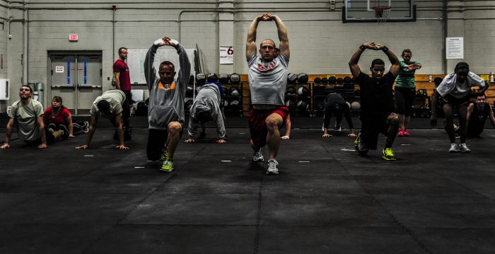 CrossFit group at gym working out