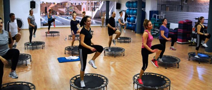 Group jumping during trampoline fitness class