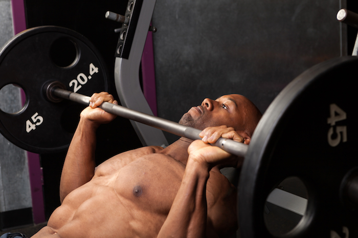 Man performing incline bench press