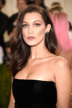 Flawless. She looked like one of those gorgeous and elegant movie stars from the 50's. So classic. SOURCE: http://www.huffingtonpost.ca/2016/05/02/the-weeknd-bella-hadid-met-gala-2016_n_9825436.html