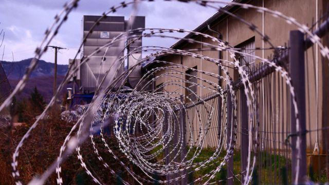Razor wire fence outside of a prison
