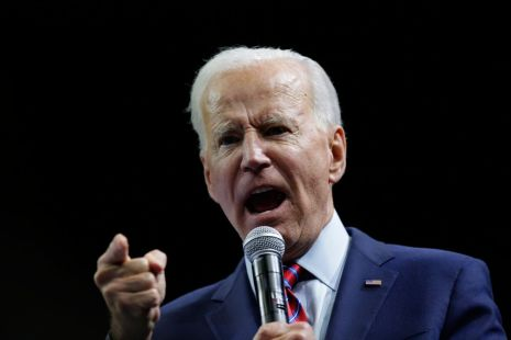 Joe Biden points while speaking into a microphone