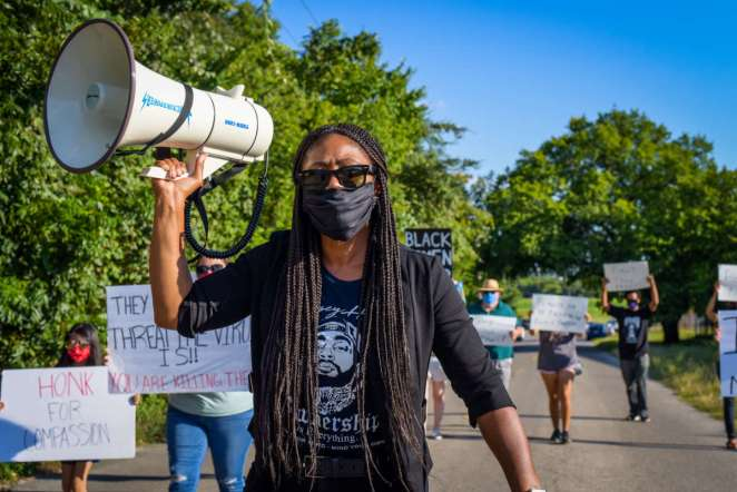 Protesters organized by the Campaign to Fight Toxic Prisons and the National Council call attention to the conditions at FMC Carswell, the only federal medical prison for women, on August 1, 2020, in Fort Worth, Texas.