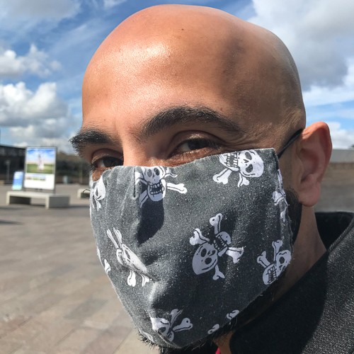 Photo of Guardian journalist Haroon Siddique wearing a COVID mask