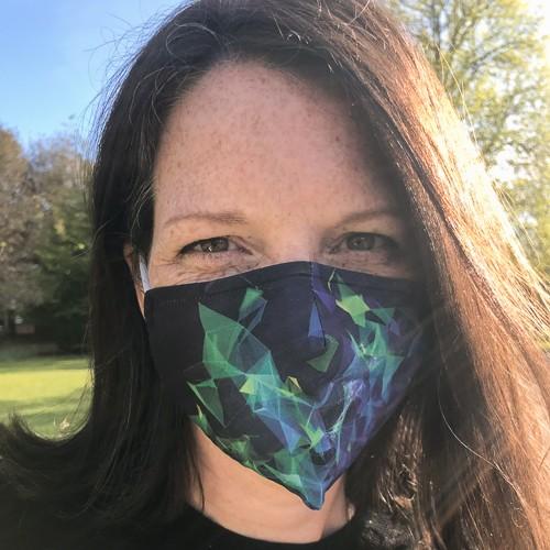 photo of Pippa Crerar - Political Editor, The Mirror wearing a COVID mask