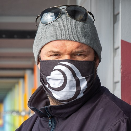 Photograph of photographer Andy Aitchison wearing a COVID mask