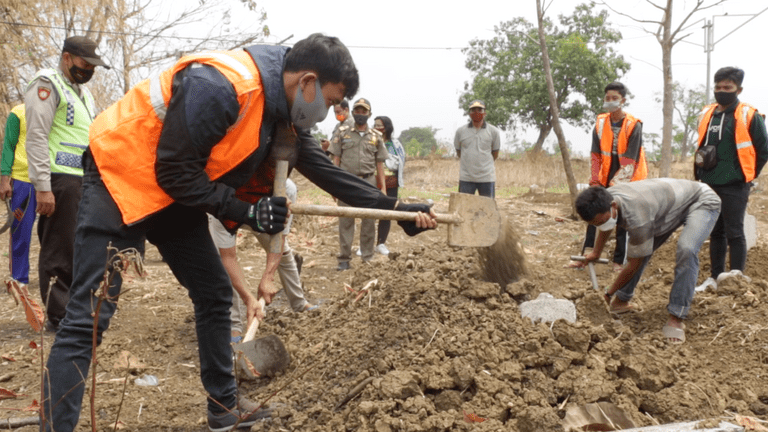 Indonesians Digging Graves