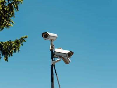 surveillance by white and black camera on tripod