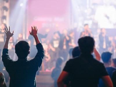 Christians worshipping at church service