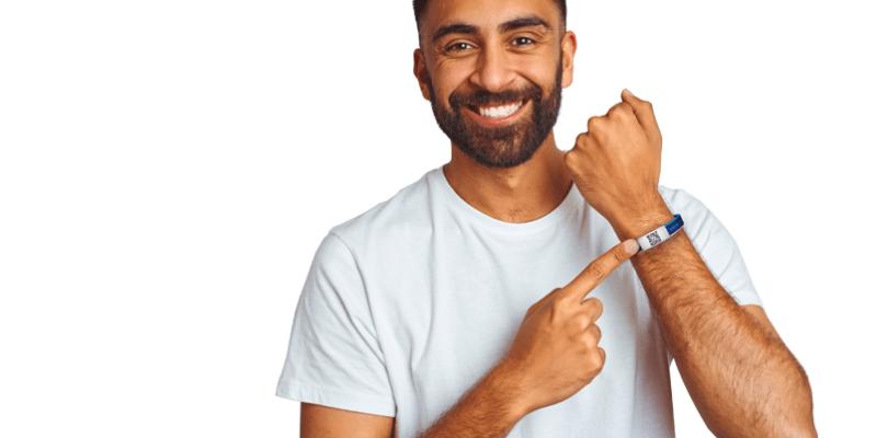 Person wearing covid vaccine wristband