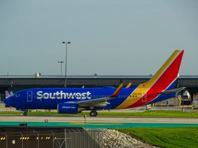 blue and yellow airliner