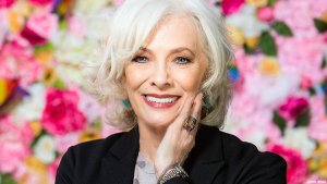 Photo of Betty Buckley against floral background