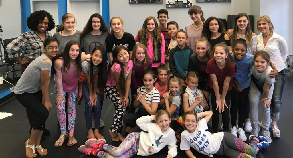 Photo of Kid & Teen Acting class at T. Schreiber Studio with group of students and teacher Jazelle Foster