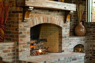 custom hand carved reclaimed wooden mantle true masonry