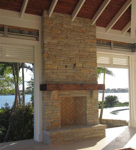outdoor fireplace limestone wood mantel craftsman