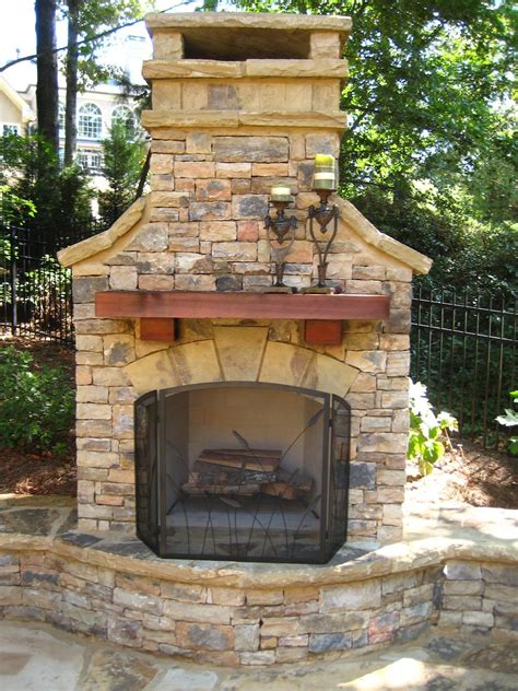 outdoor fireplace wood mantel seating wall