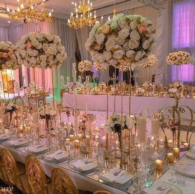 gold metal wedding pillar aisle road leads flower