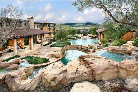 epic garden swimming pool rockery bridge outdoor luxury