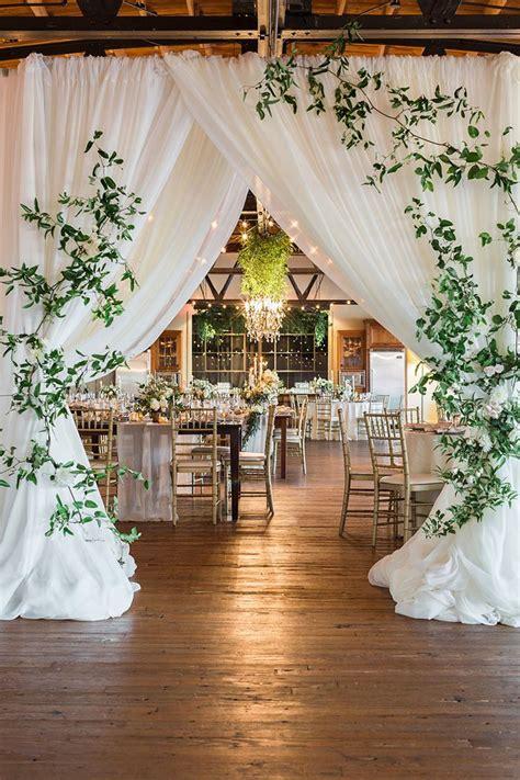 earthy organic wedding style modern greenery wedding entrance