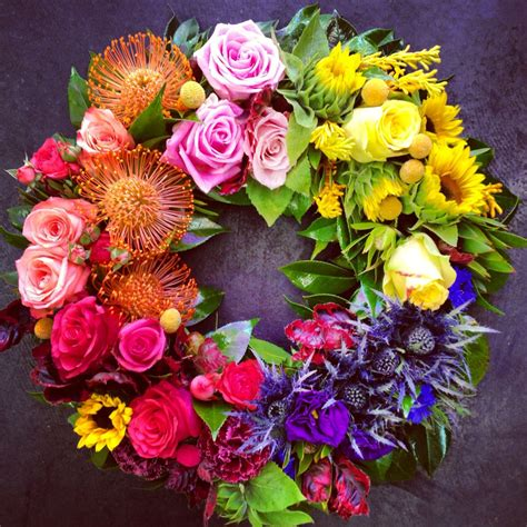 rainbow flower wreath roses sunflowers seasonal flowers colours