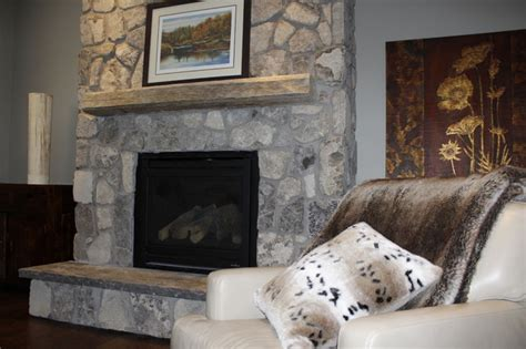 beach stone fireplace driftwood mantle rustic