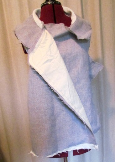 The jacket shell with muslin interllining, attached to the under collar.