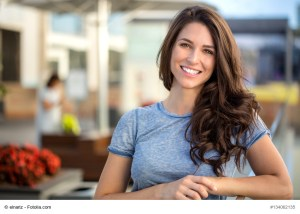 Woman similing with a beautiful brunette woman sincere happy cheerful positive expression