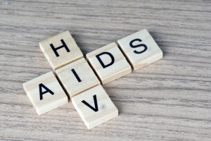 AIDS/HIV word on a wooden table