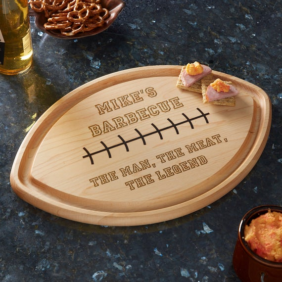 What is a good gift for dad birthday- Personalized Football Shaped Cutting Board.