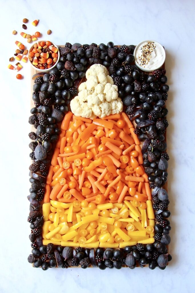 Candy Corn Snack Board - cute Halloween food ideas for party