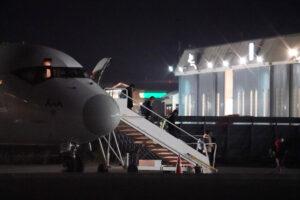Biden flying migrants into New York at night