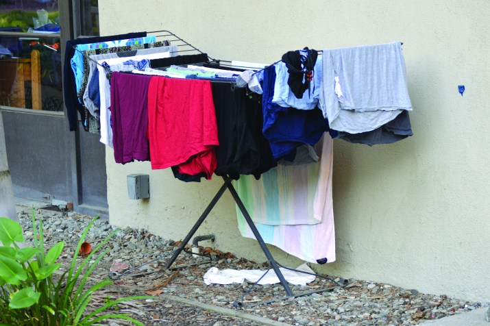 A laundry rack with clothes hung out to dry.