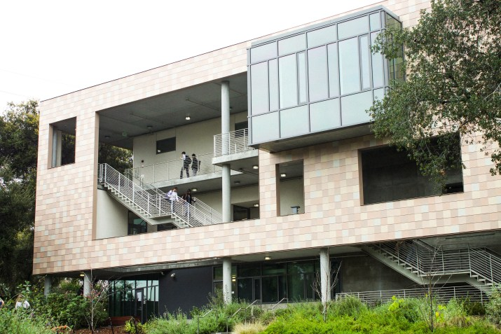 exterior of a harvey mudd dormitory: a grey modern building with large windows
