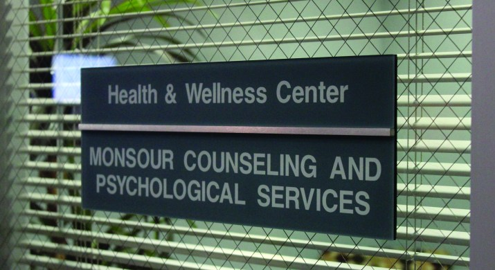 """a nameplate that reads """"health and wellness center"""" and another below reading """"monsour counseling and psychological services"""" on a door."""