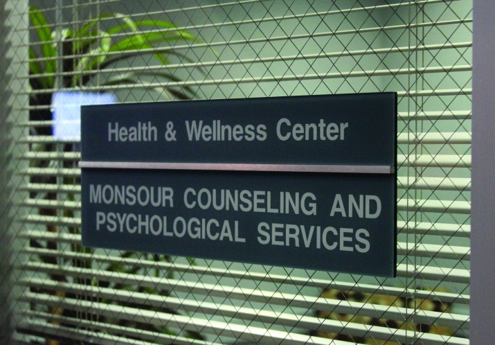 "The window of the ""Health & Wellness Center"" at Monsour Counseling and Psychological Services"