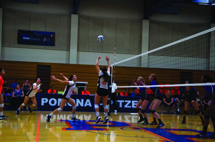 Female volleyball players in the middle of a game