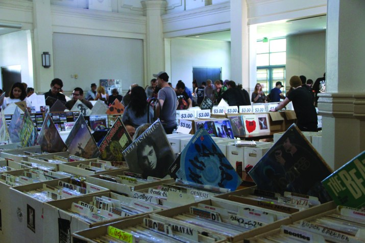 People looking through boxes of vinyls