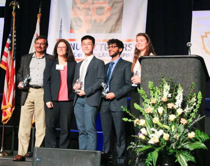 Engineering Professor Kash Gokli stands with Harvey Mudd College juniors Bohan Gao, Ankoor Apte and Rachel Perley at the Manufacturer's Council of the Inland Empire Innovation Award ceremony.