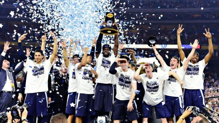 The Villanova men's basketball team celebrates by hoisting trophy into air