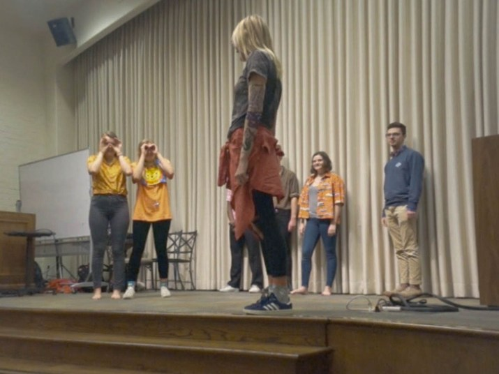 An improv group performs onstage