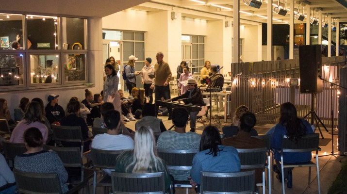 A group of students sitting at a Wellness Week event.