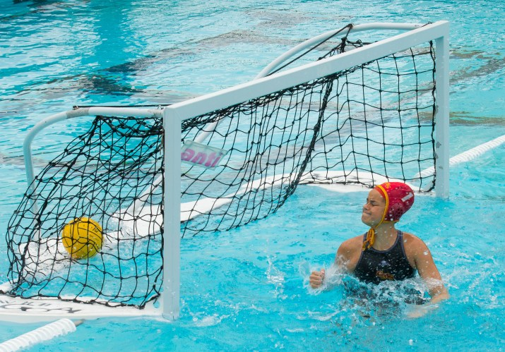 The CMS goalie grimaces as she watches the ball hit the back of the net.