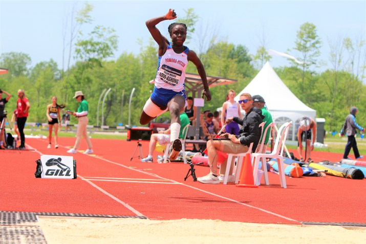 A woman jumps on a track