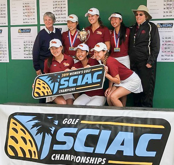 The women's golf team poses with their trophy and the SCIAC Champions sign.
