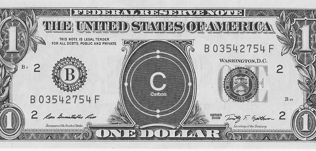 1-dollar bill with the atomic symbol for carbon in the center