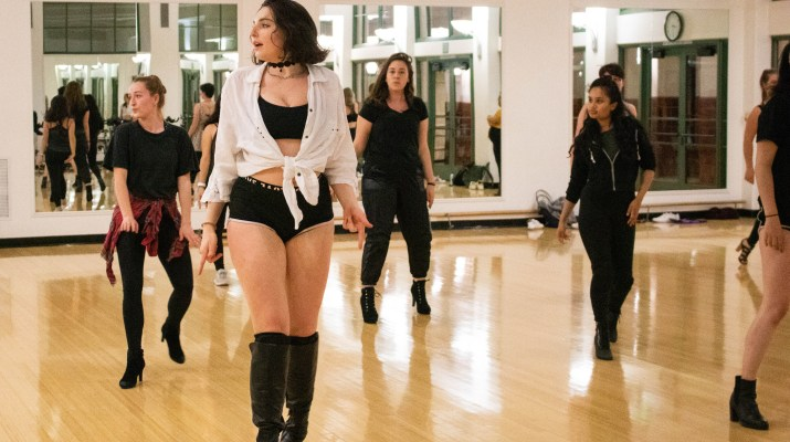 Two girls demonstrate choreography to a dance class.